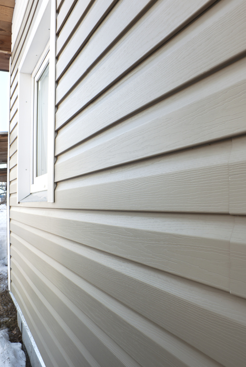 Roofing Contractors Forest Lake MN - New Siding on a House